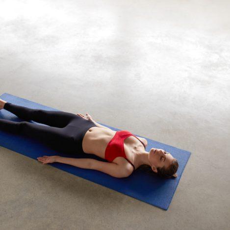 Girl lyin, resting after practice, meditating